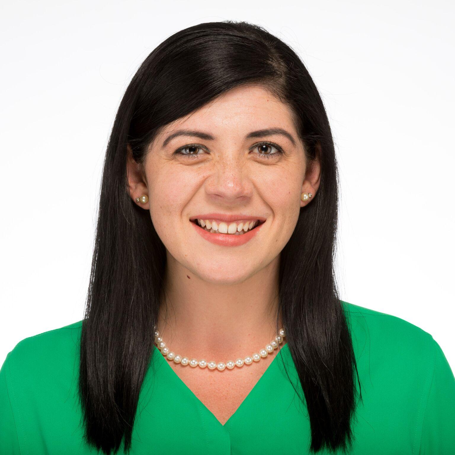 Jenna smiling and wearing a green shirt