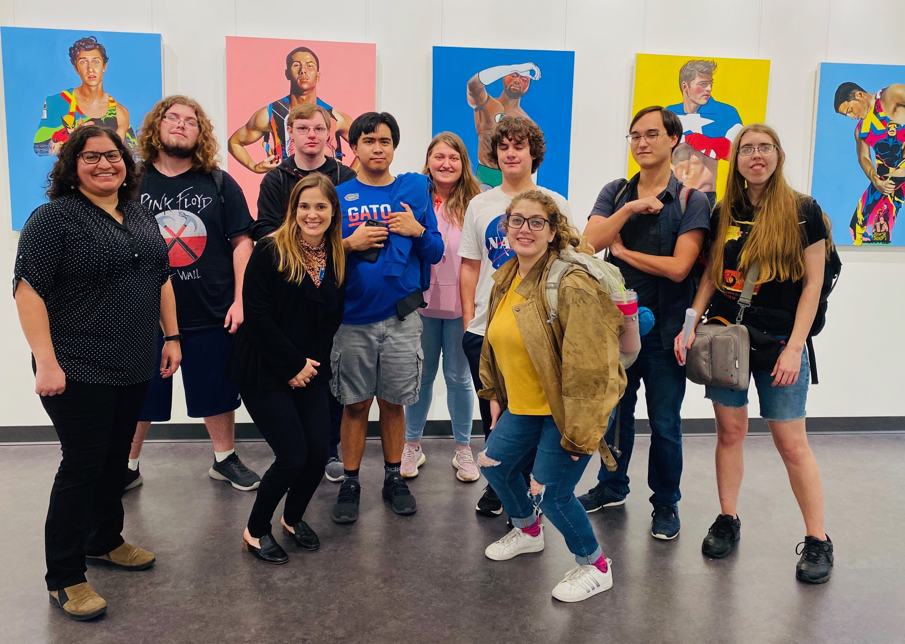 A group of social Gators students at the art gallery in the Reitz